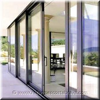 Cerramientos de aluminio y pvc puertas aluminio puertas for Lift and slide doors cost